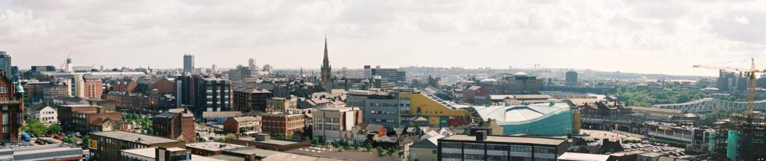 Image of Newcastle cityscape from the Tyne across the Centre for Life towards the Discovery Musueum dating from approx 2003.